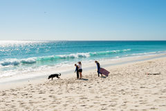 Family on the beach at Bloubergstrand in South Africa, facing Table Mountain. Stock Image