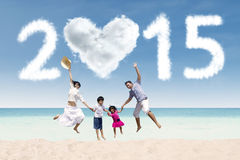 Family at beach with cloud of 2015 Stock Photo