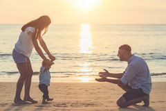 Family on the beach, Mother holding hand of her son and walking,. Family on the beach concept, Mother holding hand of her son and walking, playing on the stock photography