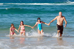 Family at the beach Stock Photo