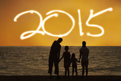 Family on beach enjoy new year 2015 Stock Image
