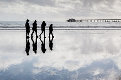 Family in a beach enjoying their quality time. Stock Images