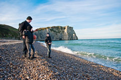 Family on the beach at Etretat, France Royalty Free Stock Images