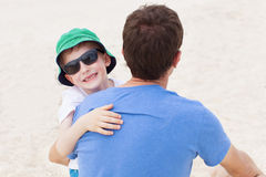 Family at the beach Stock Images