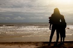 Family on the beach. Freedom woman and boy silhouette Lonely on the beach, female adult and boy young at holidays in Asia Thailand Stock Image