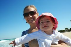 Family beach fun. A mother and daught enjoy a moment at the beach Royalty Free Stock Images