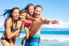 Family on the Beach Stock Photography