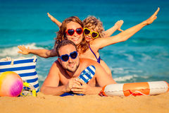 Family at the beach. Happy family playing at the beach. Summer vacation concept Royalty Free Stock Image