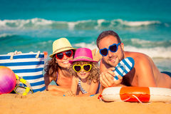 Family at the beach. Happy family playing at the beach. Summer vacation concept Royalty Free Stock Photo