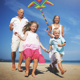 Family Beach Holiday Flying Kite Sea Togetherness Concept Royalty Free Stock Photo
