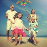 Family Beach Holiday Flying Kite Sea Togetherness Concept Stock Photos