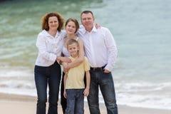 Family on a beach Royalty Free Stock Photos
