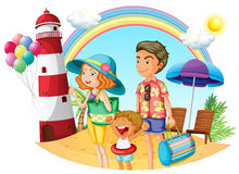 A family at the beach with a lighthouse Stock Photos