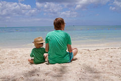 Family on the beach of Mauritius Stock Photography