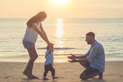 Family on the beach, Mother holding hand of her son and walking,. Family on the beach concept, Mother holding hand of her son and walking, playing on the royalty free stock photos
