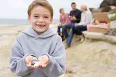 Family at beach with picnic and boy smiling Royalty Free Stock Photo