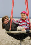 Family in beach playground. Mother and her son in beach playground. Windy summer day Royalty Free Stock Photos