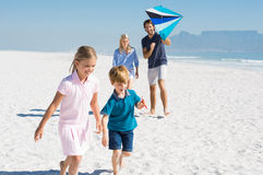 Family at beach playing royalty free stock image