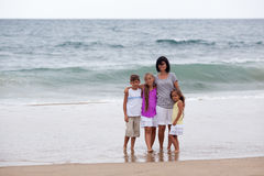 Family on the beach Royalty Free Stock Photos