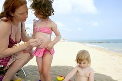 Family on the beach sun screen moisture Royalty Free Stock Images