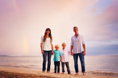 Family on the Beach at Sunset Stock Image