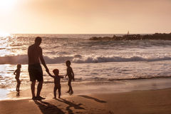 Family is at the beach. Royalty Free Stock Photo
