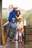 Family on beach with umbrella Stock Photography
