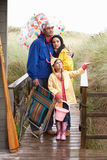 Family on beach with umbrella Royalty Free Stock Image