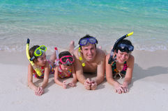 Family on beach vacation. Family in snorkels on tropical beach Stock Photos
