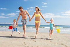 Family on beach vacation. Running towards camera stock photo