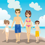 Family Beach Vacation. Happy family enjoying beach vacation walking on sand Royalty Free Stock Image