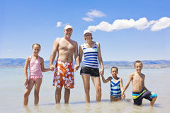 Family on a beach vacation together Stock Photos