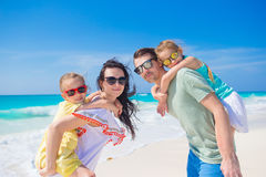 Family beach vacation. Young family of four on beach vacation Stock Photos