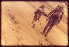 Family beach walk Stock Images