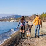 Family at the beach during the warm winter Royalty Free Stock Photo