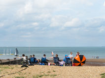 A family on the beach in Whitstable, Kent, Uk. Stock Images