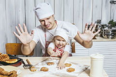 Family, beautiful daughter dad at home the kitchen laughing and Royalty Free Stock Images
