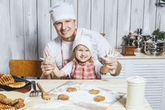 Family, beautiful daughter dad at home the kitchen laughing and royalty free stock photo