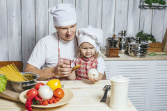 Family, beautiful daughter dad at home the kitchen laughing and Royalty Free Stock Photography