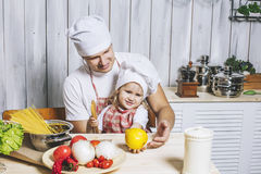 Family, beautiful daughter dad at home the kitchen laughing and Royalty Free Stock Photos