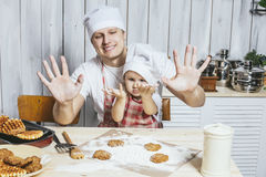 Family, beautiful daughter dad at home the kitchen laughing and Stock Images