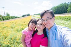 Family with landscape in Furano royalty free stock image