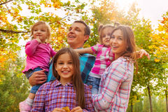 Family with beautiful little girls in autumn park Stock Image