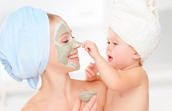 Family beauty treatment in  bathroom. mother and daughter baby g Stock Photos