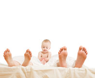 Family in bed Stock Images