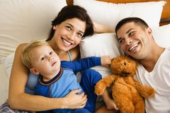 Family in bed. Stock Photos