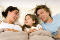 Family in bed Stock Photo