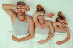 Family bed. Funny bed family tired concept royalty free stock photography