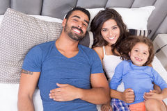 Family in bed. Happy family enjoying the morning in bed stock photography