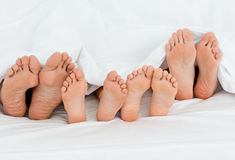 Family on the bed  at home Stock Photos